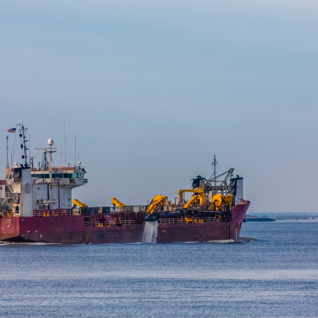"""Dredging Ship in Harbor"" stock image"