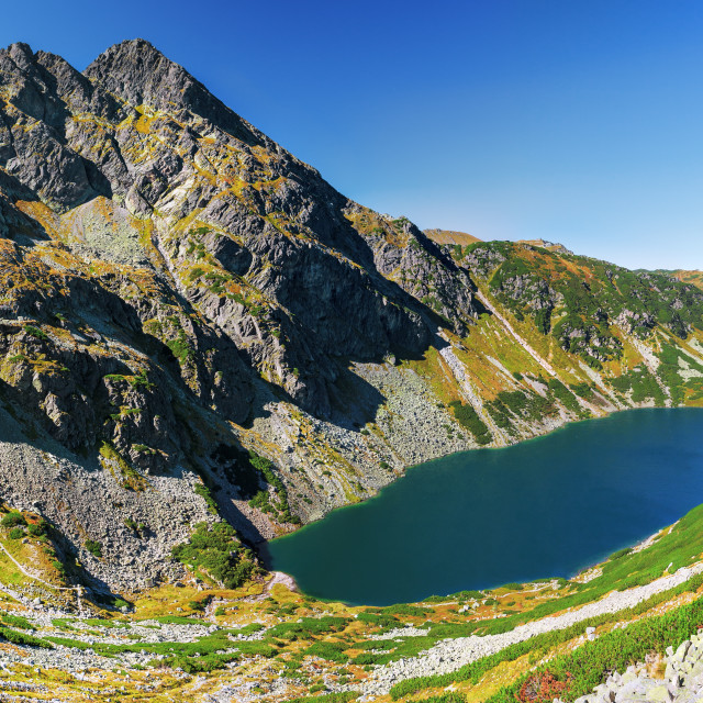 """Panorama of Gasienicowy Black Pond and Maly Koscielec Peak surrounding from route to Skrajny Granat Peak, high Tatra mountains"" stock image"