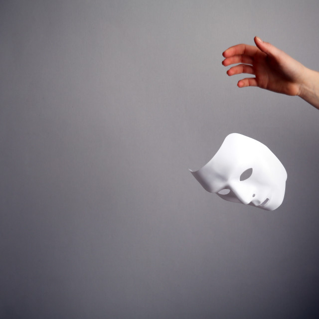 """""""The mask is a symbol of duplicity."""" stock image"""