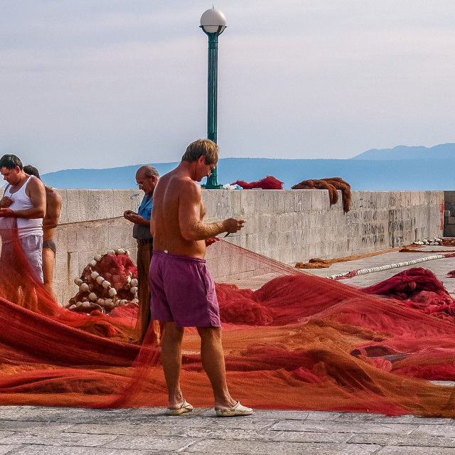"""Mending the Nets - Lovran, Istria, Croatia"" stock image"