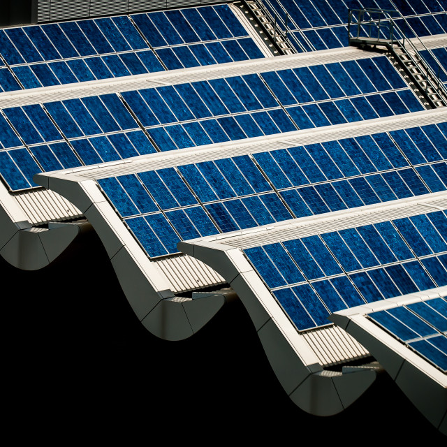 """""""Banks of solar panels on the roof of a building"""" stock image"""