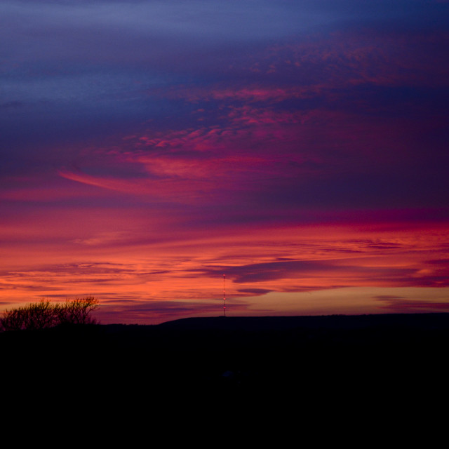 """""""Deep Red and Purple Sunset Afterglow"""" stock image"""