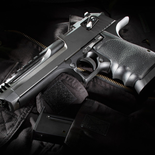 """Black semi automatic handgun on a bag"" stock image"