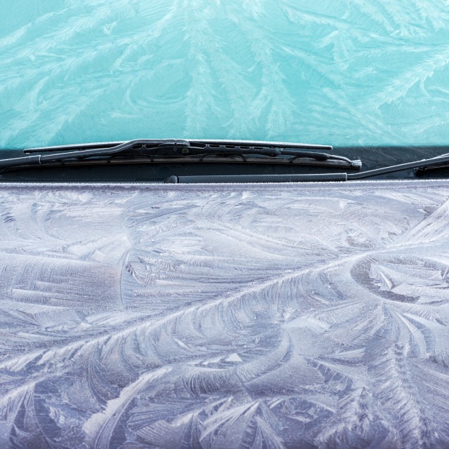 """Hoar frost patterns on car bonnet and windscreen"" stock image"