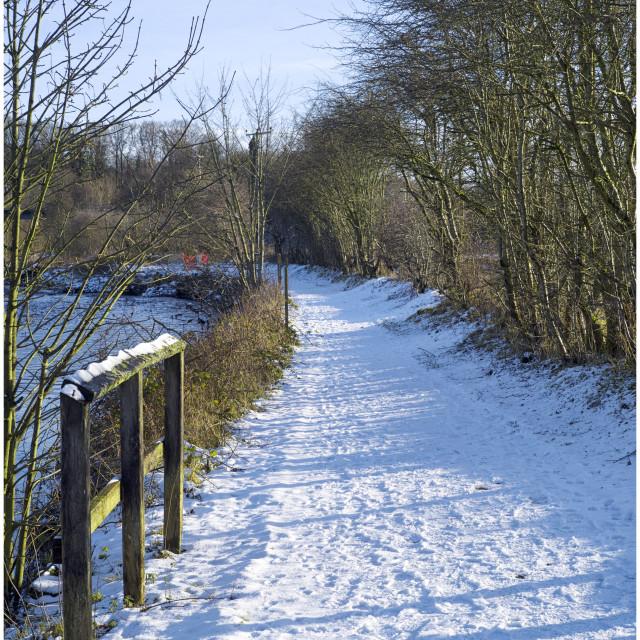 """Riverside Path in snow"" stock image"