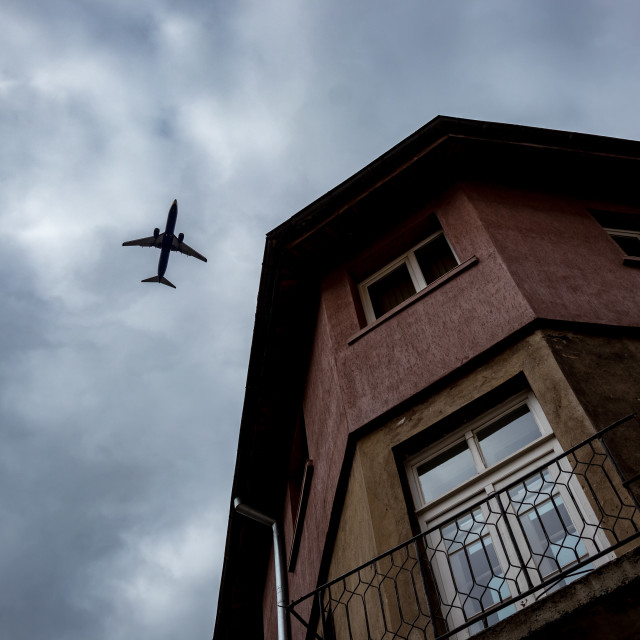 """""""Airplane silhouette and house in Sofia, Bulgaria"""" stock image"""