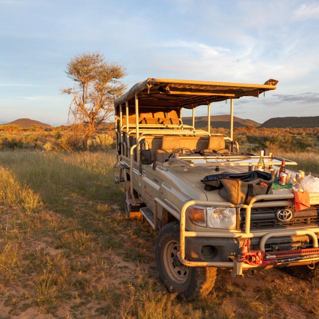 """""""Sunset on tourist Toyota Landcruiser, near Okonjima"""" stock image"""