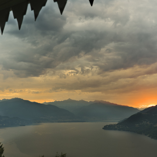 """""""Sunrise in front of Lake Maggiore in the beautiful town of Cannobio."""" stock image"""