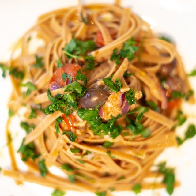 """Italian Pasta onion, tuna, and taggiasche olives"" stock image"