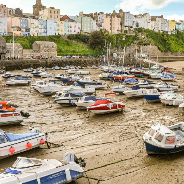 """""""Small boats in the harbour in Tenby, West Wales, at low tide"""" stock image"""