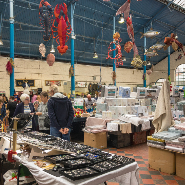 """Shoppers in the indoor market in Abergavenny"" stock image"