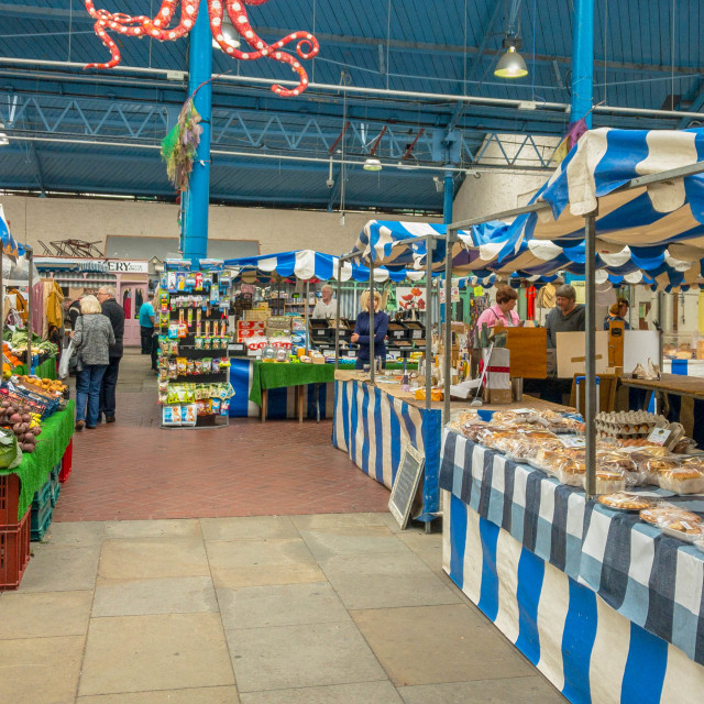 """Stalls in the indoor market in Abergavenny"" stock image"