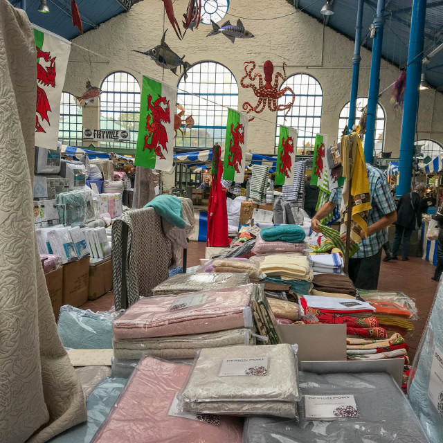 """A bedding stall in the indoor market in Abergavenny"" stock image"