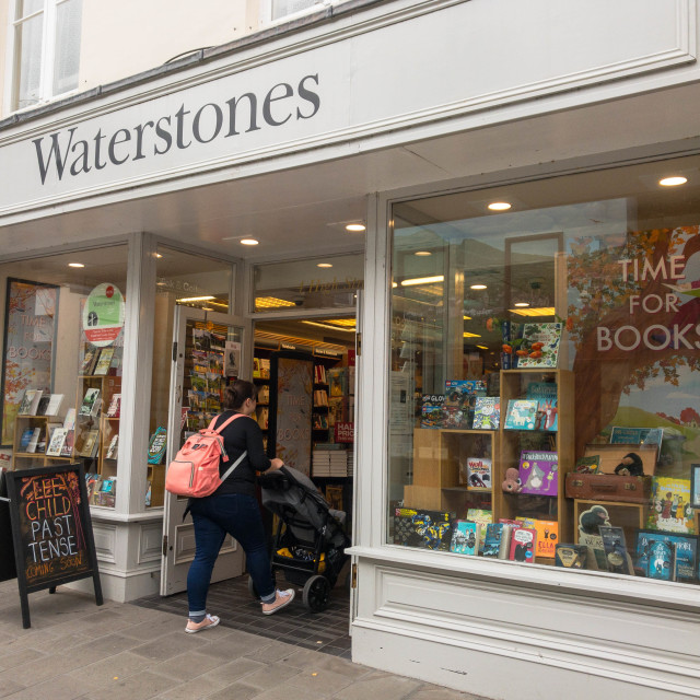 """Shopper entering the Waterstones store in Abergavenny town centre"" stock image"