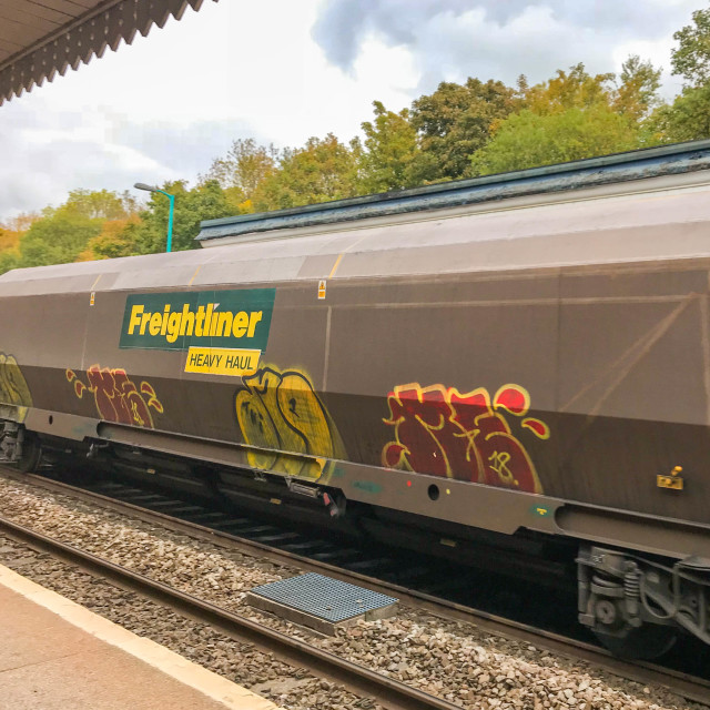 """Freightliner Heavy Haul wagon on a train passing through Abergavenny station."" stock image"
