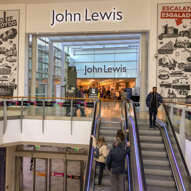 """""""Shoppers at the entrance to the John Lewis store in the St David's shopping centre in Cardiff"""" stock image"""