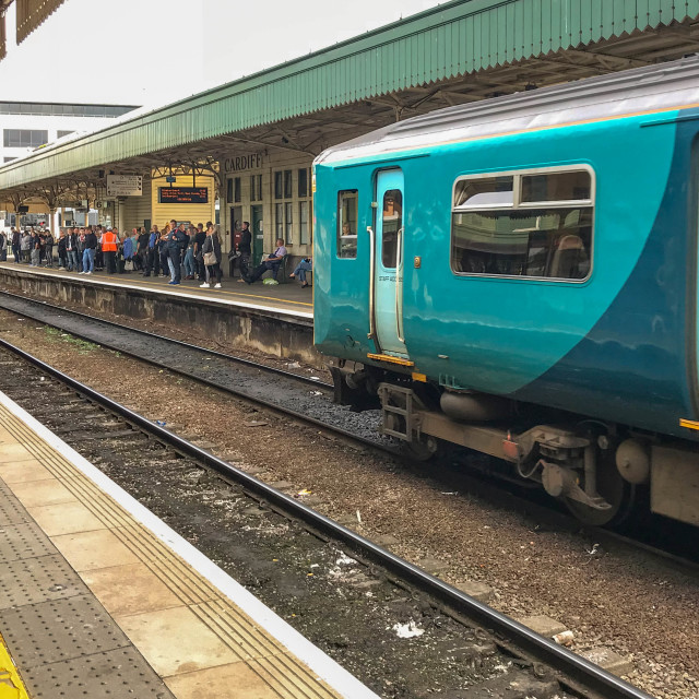 """Passengers waiting at Cardiff Central station as a train arrives."" stock image"