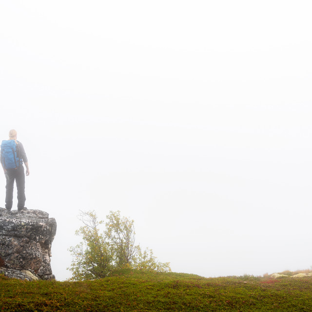 """Hiker on foggy mountain"" stock image"
