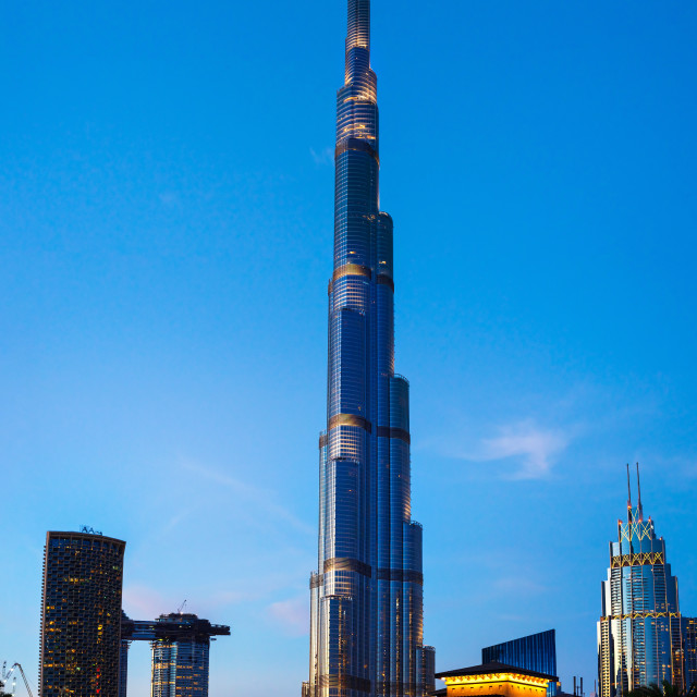 """""""Burj Khalifa and spinning mirrors and light art installation in Burj plaza of Downtown Dubai at blue hour"""" stock image"""