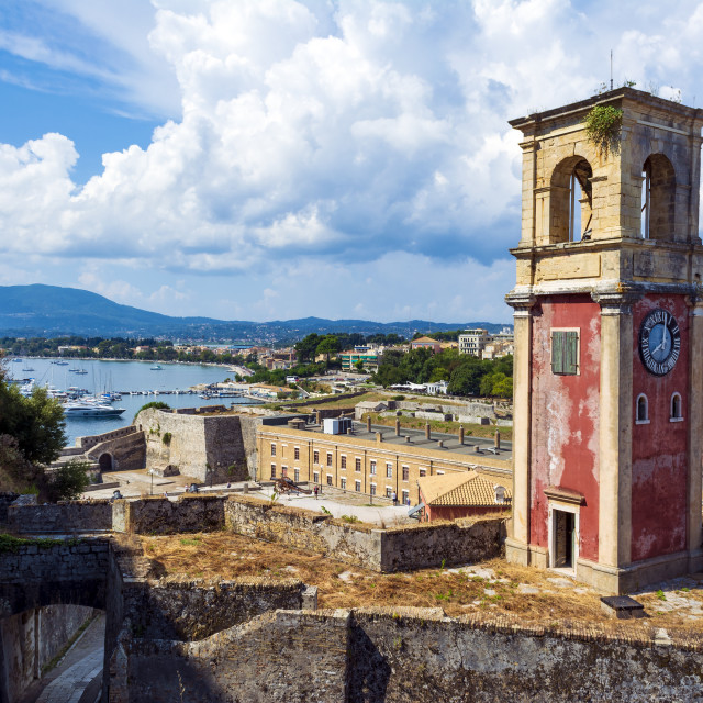 """""""Abandoned clock tower in old fortress in Corfun with panoramic view of Corfu..."""" stock image"""