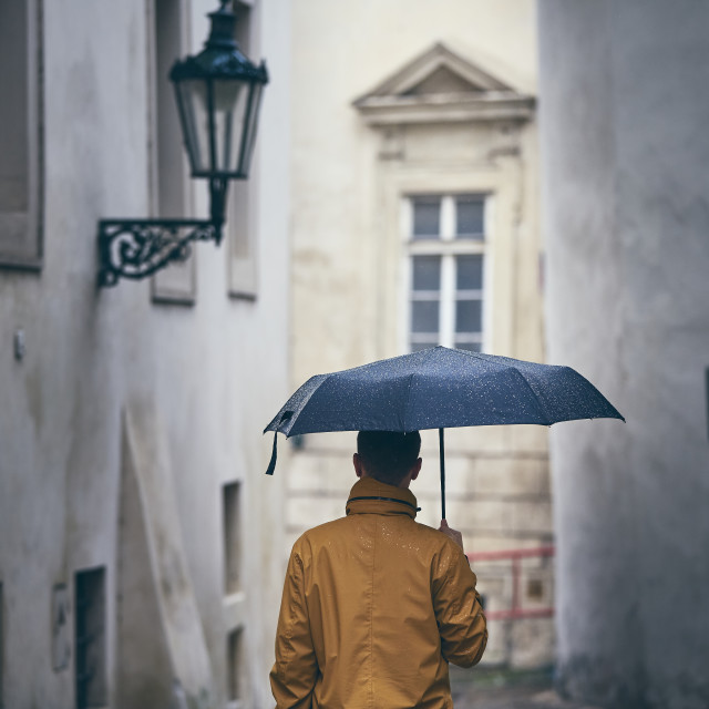 """Lonely man with umbrella in rain"" stock image"
