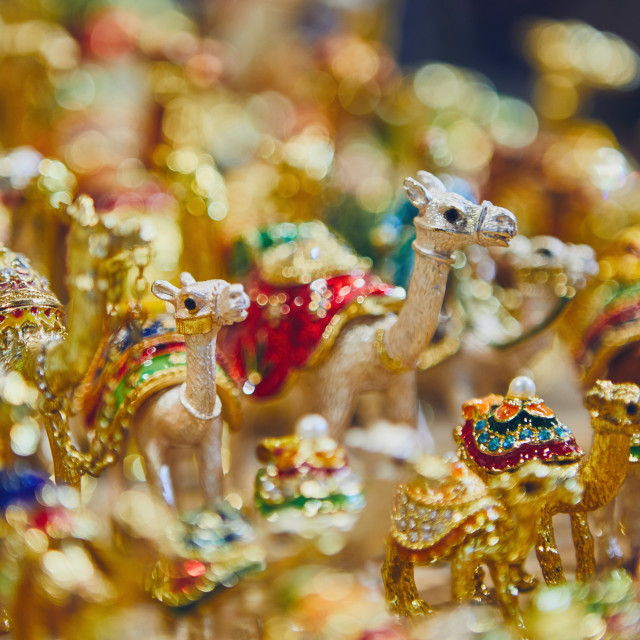 """Souvenirs of camels at souq in Muscat"" stock image"
