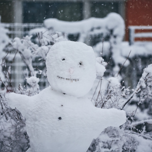 """""""Big snowman in the city"""" stock image"""