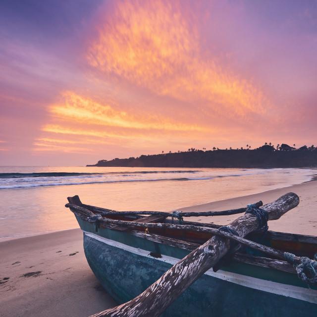 """Colorful sunrise on the beach"" stock image"