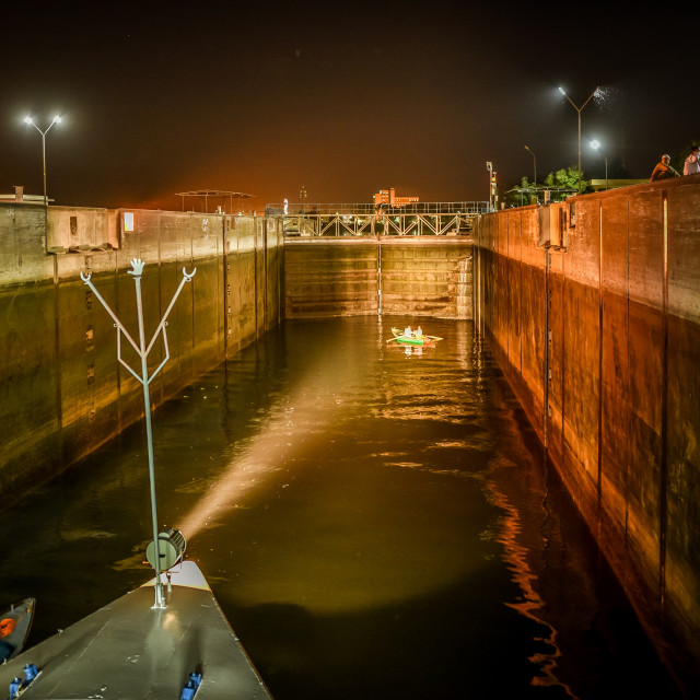 """A cruiser is sailing into the lock of Esna at night"" stock image"