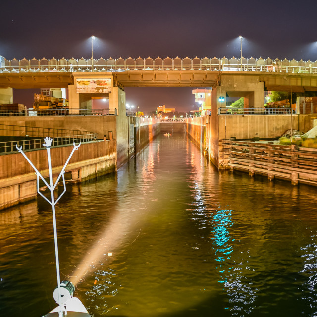 """Sailing into the lock of Esna at night"" stock image"