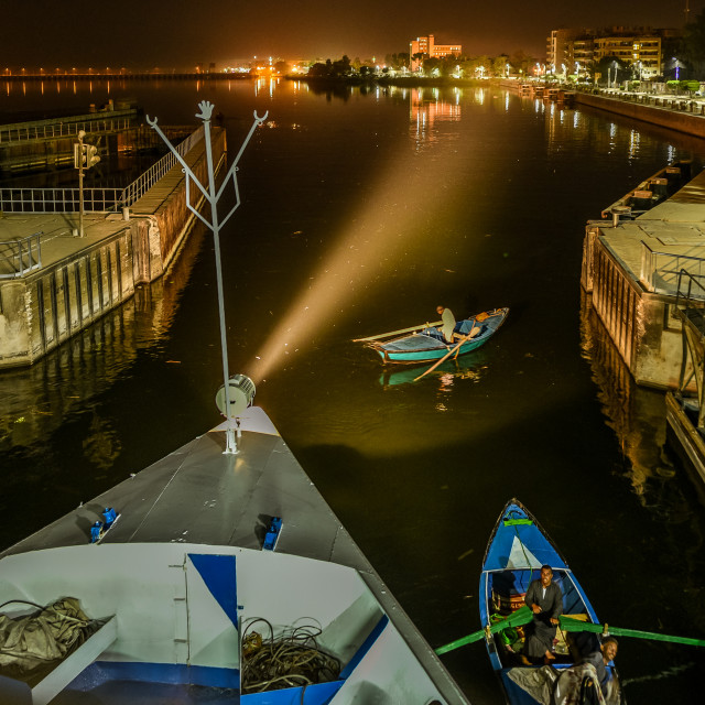 """""""the water gate of Esna in the river Nile is opening at night"""" stock image"""