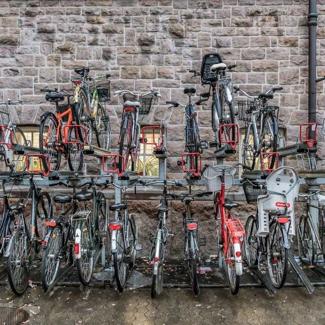 """Cycle rack against a brick-wall"" stock image"
