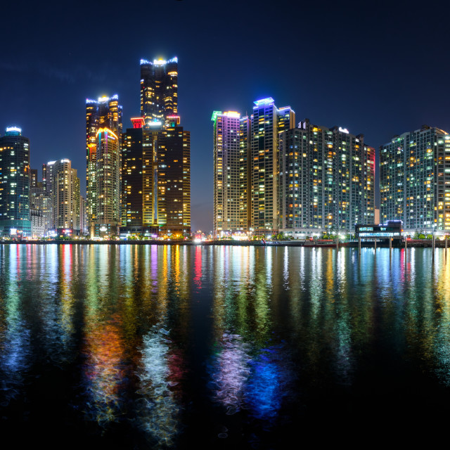 """Busan Marina city skyscrapers illluminated in night"" stock image"