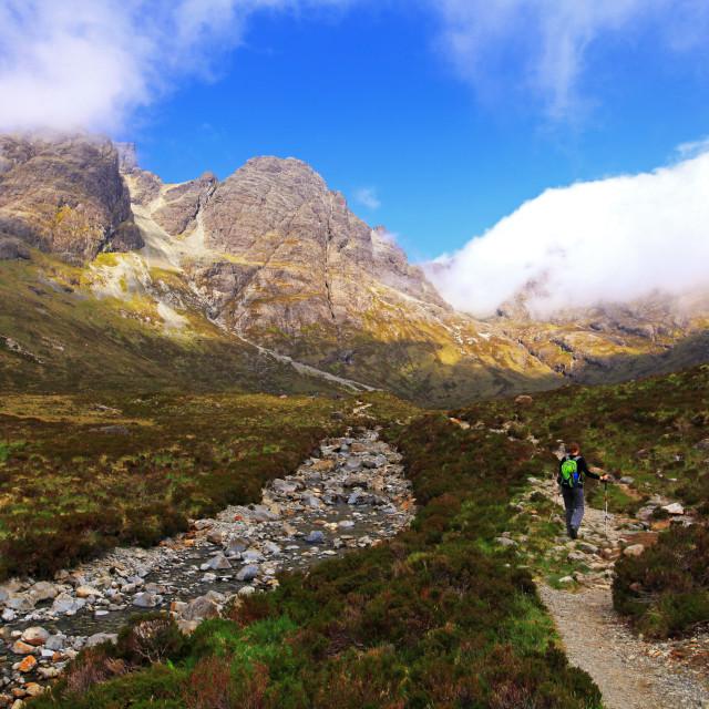 """Hiker in Cuillin Hills, Isle of Skye"" stock image"