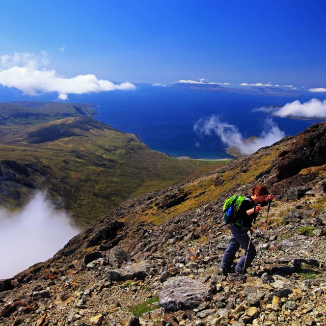 """Hiker on their way up to Bla Bheinn (Blaven), Isle of Skye"" stock image"