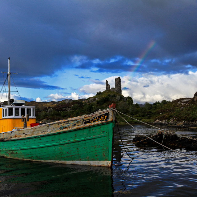 """Boat with rainbow and ruined castle Caisteal Maol"" stock image"