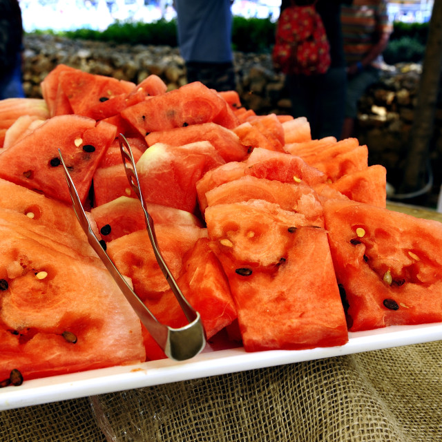"""Herbs on freshly sliced watermelon"" stock image"
