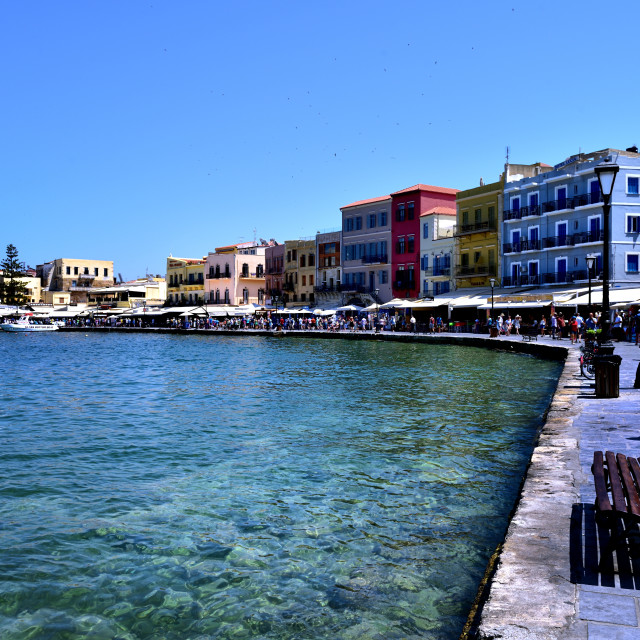 """""""Visitors exploring the restaurants and shops of Chania harbour"""" stock image"""