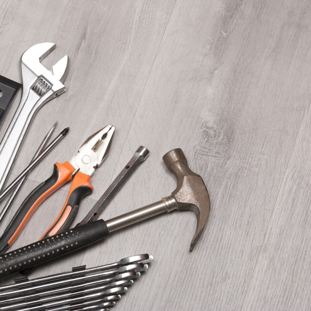 """""""Hammer and wrenches on desk"""" stock image"""