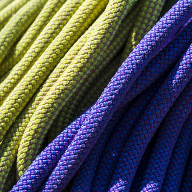 """""""Close-up yellow and purple colorful ropes in sunlight"""" stock image"""