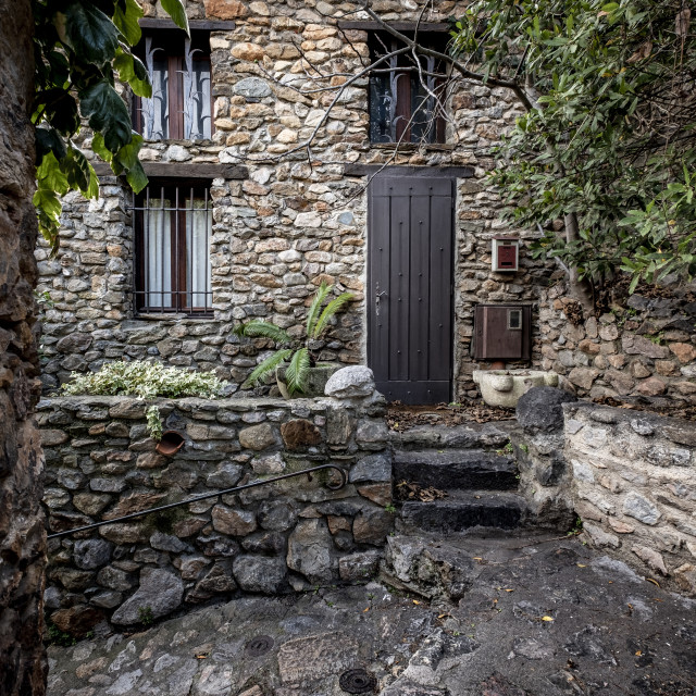 """Rustic architecture in the village of Castelnou, within the list of Les plus beaux towns of France"" stock image"