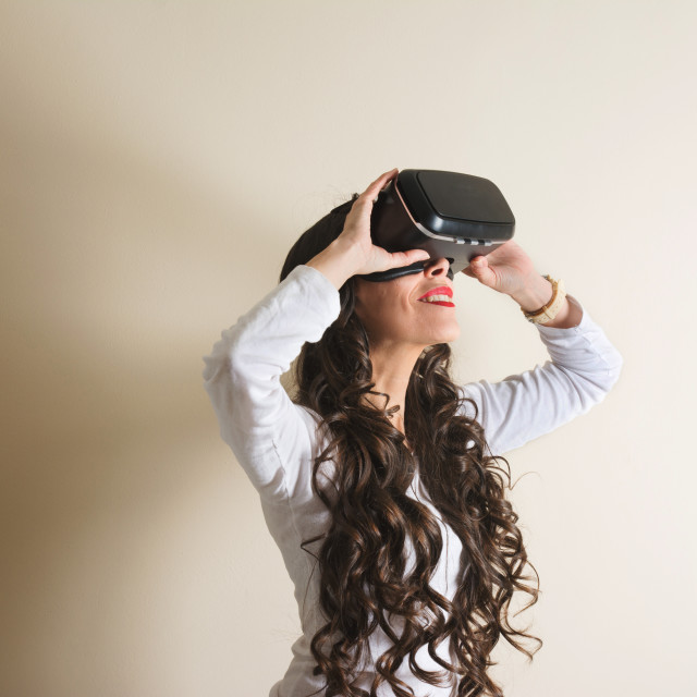 """Woman in virtual reality helmet. VR glasses."" stock image"