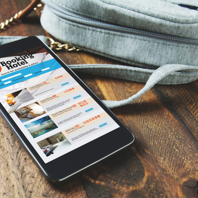"""""""Booking hotel online,by smartphone . Travel and tourism concept."""" stock image"""