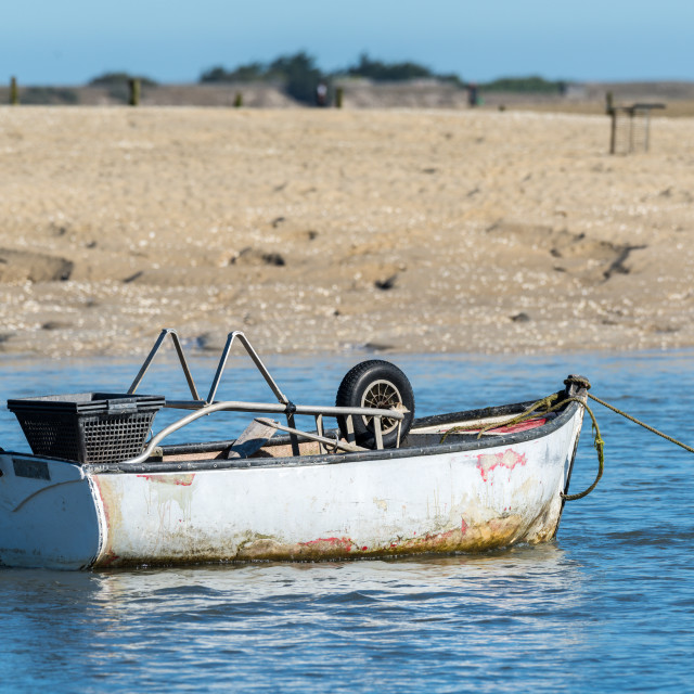 """""""Small withe boat at low tide"""" stock image"""