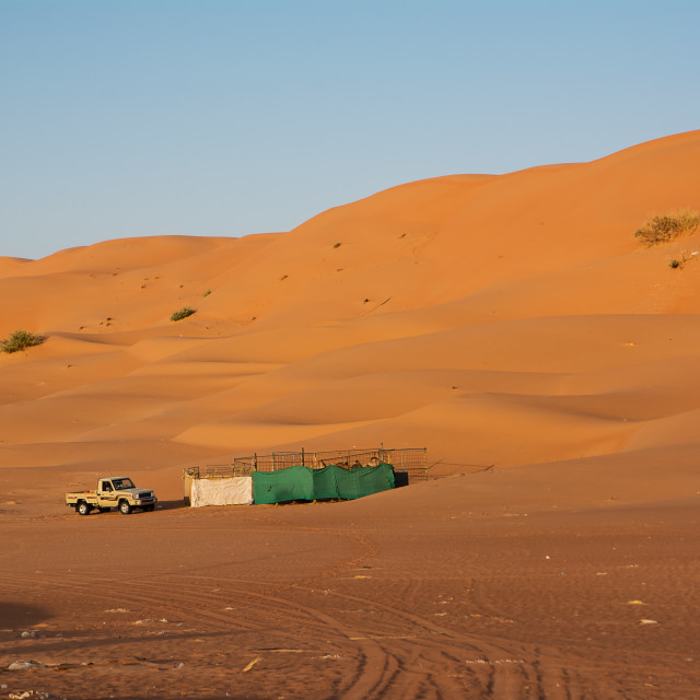 """""""Animal fence and car pickups under desert dunes wahiba sands at"""" stock image"""
