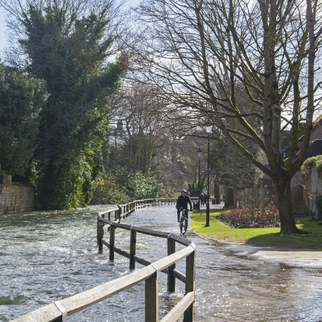 """Flooded footpath in Winchester town."" stock image"