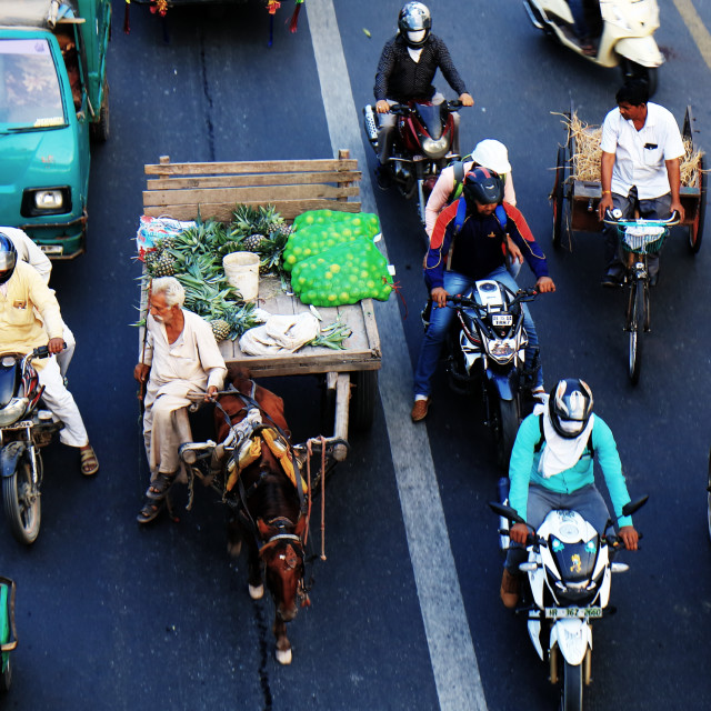 """""""NEW DELHI INDIA - OCTOBER 28, 2017: Unidentified people commute in downtown New Delhi."""" stock image"""