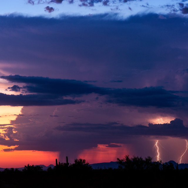 """""""Thunderstorm cloud with colorful sunset sky"""" stock image"""