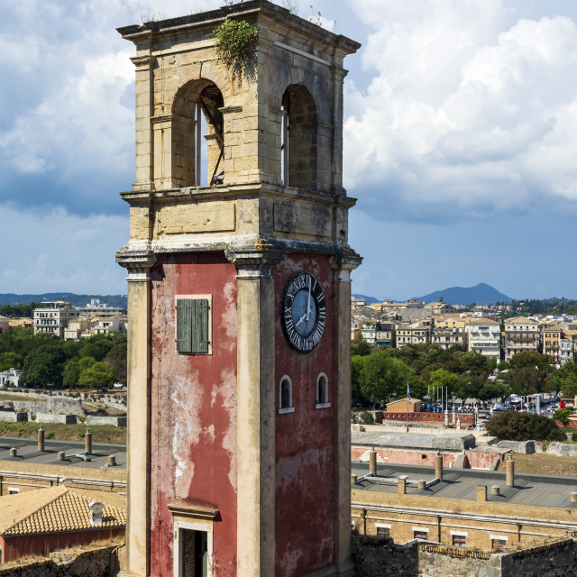 """""""Abandoned clock tower in old fortress in Corfu with panoramic view of Corfu..."""" stock image"""