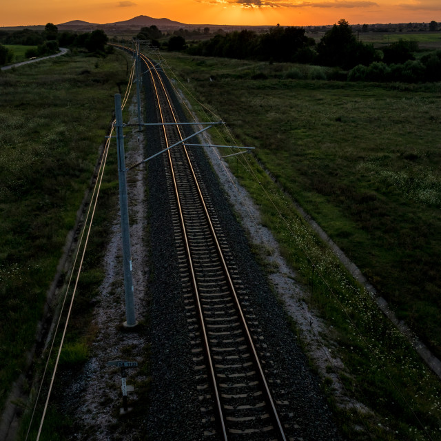 """""""Railway tracks from above at sunset behind clouds"""" stock image"""